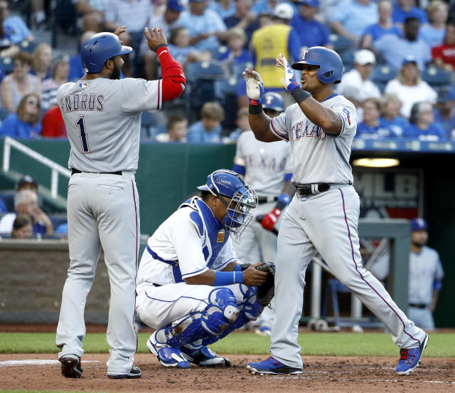 Texas Rangers' Adrian Beltre, right, celebrates with Elvis Andrus (1) after hitting a three-run home run during the third inning of a baseball game against the Kansas City Royals Monday, June 18, 2018, in Kansas City, Mo. (AP Photo/Charlie Riedel)