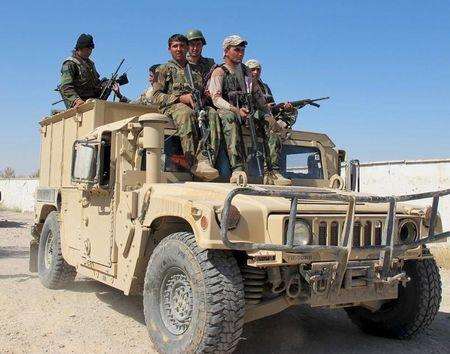 Afghan security forces arrive to fight with Taliban forces in Helmand, Afghanistan