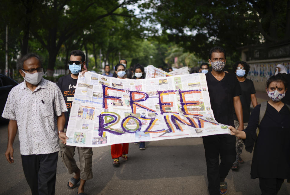 Bangladeshi artists carry an artwork during a protest against the arrest of Rozina Islam in Dhaka, Bangladesh, Thursday, May 20, 2021. Islam, a journalist in Bangladesh known for her strong reporting on official corruption has been arrested on charges of violating a colonial-era official secrets act which carries a possible death penalty. (AP Photo/Mahmud Hossain Opu)
