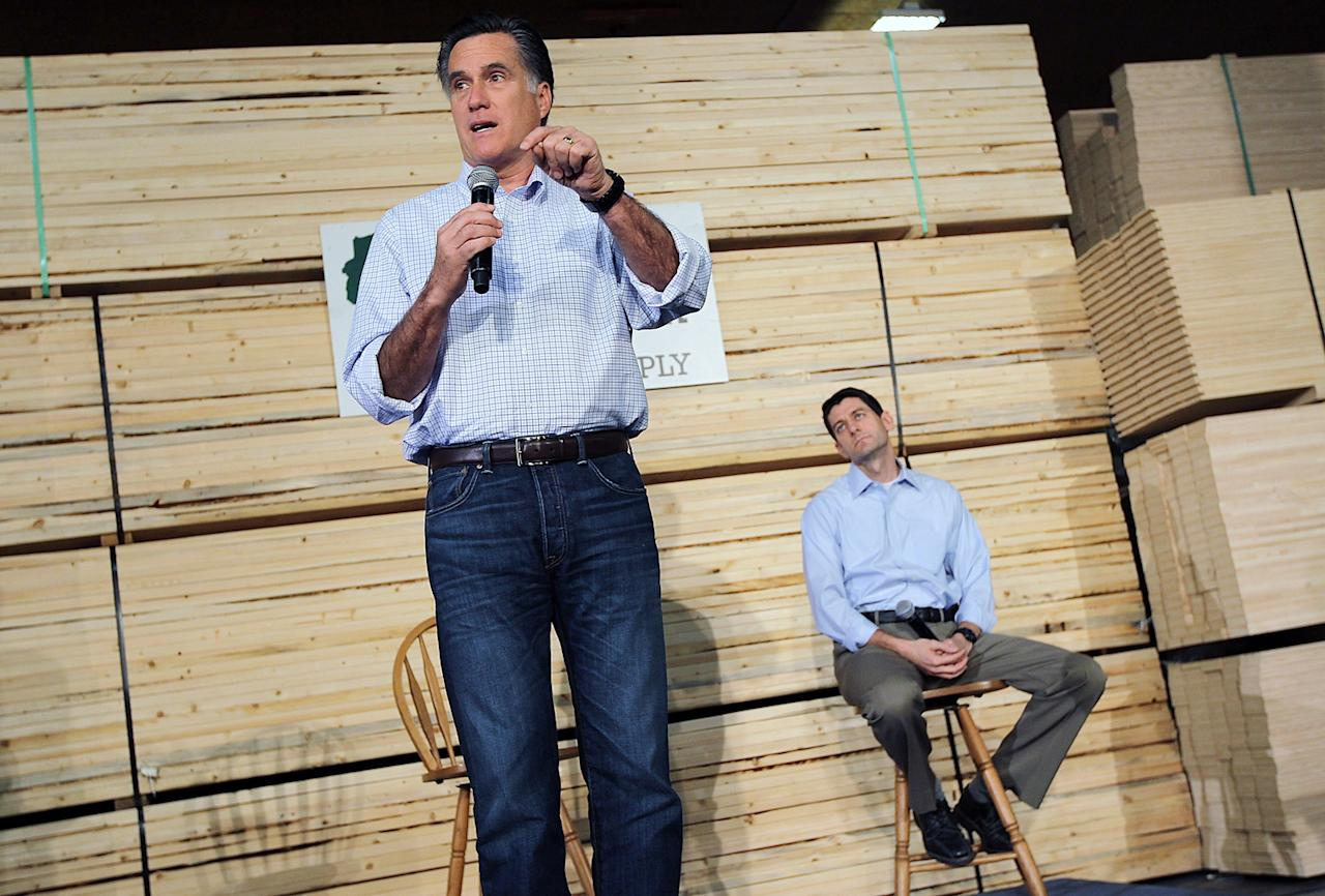 Republican Presidential candidate, former Massachusetts Gov. Mitt Romney (L) speaks during a town hall style meeting as U.S. Rep Paul Ryan (R-WI) looks on at Wisconsin Building Supply on April 2, 2012 in Green Bay, Wisconsin. With one day to go before the Wisconsin primary, Mitt Romney makes a final push through the state.  (Photo by Justin Sullivan/Getty Images)