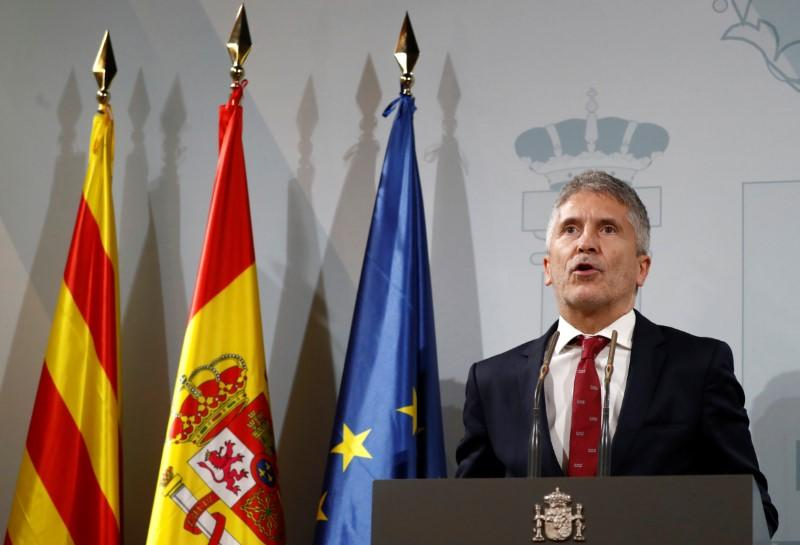 Spain's acting Interior Minister Fernando Grande-Marlaska speaks at a news conference after holding meeting with police commanders in charge of the police operation in Catalonia, in Barcelona