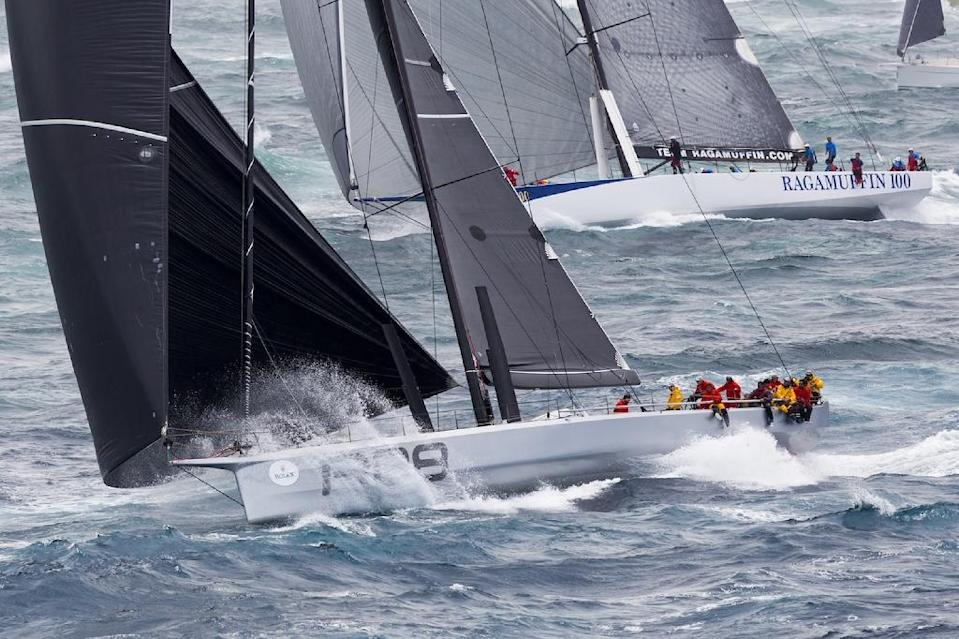 US Supermaxi yacht Rambler (L) races against Ragamuffin 100 in the Sydney to Hobart yacht race on December 26, 2015 (AFP Photo/Stefano Gattini)