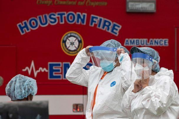 PHOTO: Medical practitioners wear personal protective equipment before entering 12200 Chessington Drive in southwest Houston, April 30, 2021. (Adrees Latif/Reuters)