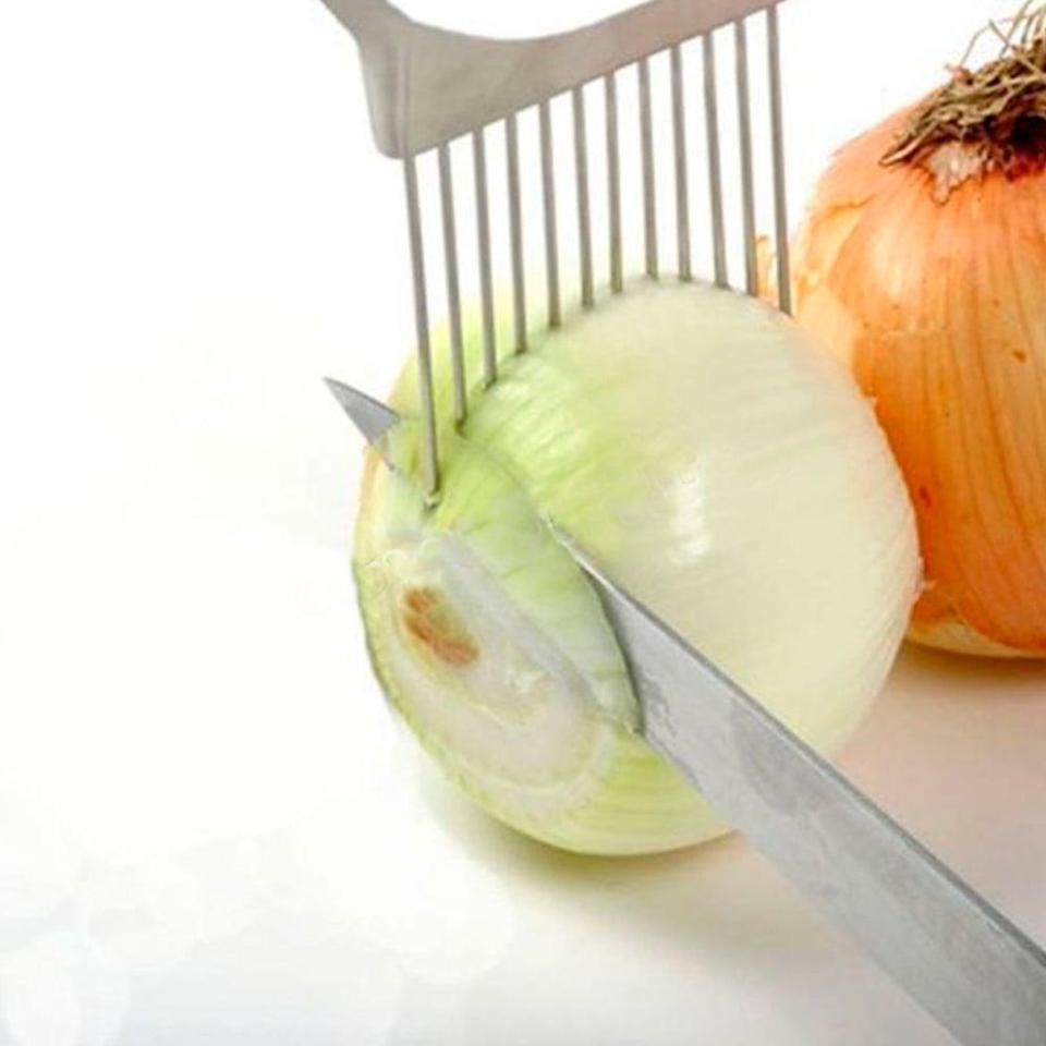 <p>This <span>Onion Tomato Vegetable Slicer Gadget</span> ($8) is weirdly satisfying to use, plus it'll cut chopping time in half.</p>