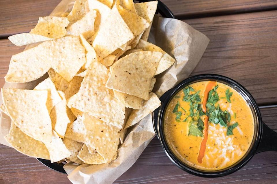 Texas transplants sing the praises of green chile queso from Austin-based Torchy's Tacos, which is opening its first North Carolina location in Raleigh.