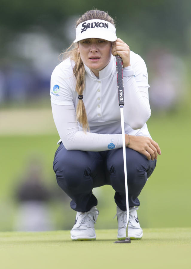 Hannah Green, of Australia, studies the green on the ninth hole during the final round of the KPMG Women's PGA Championship golf tournament, Sunday, June 23, 2019, in Chaska, Minn. (AP Photo/Andy Clayton-King)