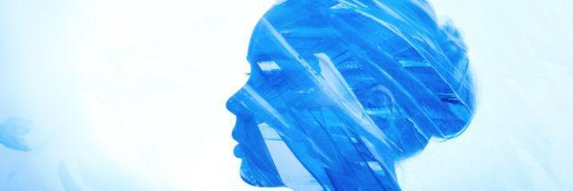 Portrait woman consisting of brush strokes of blue paint on a white background.