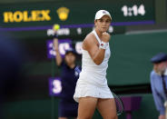 Australia's Ashleigh Barty celebrates winning a point against Czech Republic's Katerina Siniakova during the women's singles third round match on day six of the Wimbledon Tennis Championships in London, Saturday July 3, 2021. (AP Photo/Alastair Grant)
