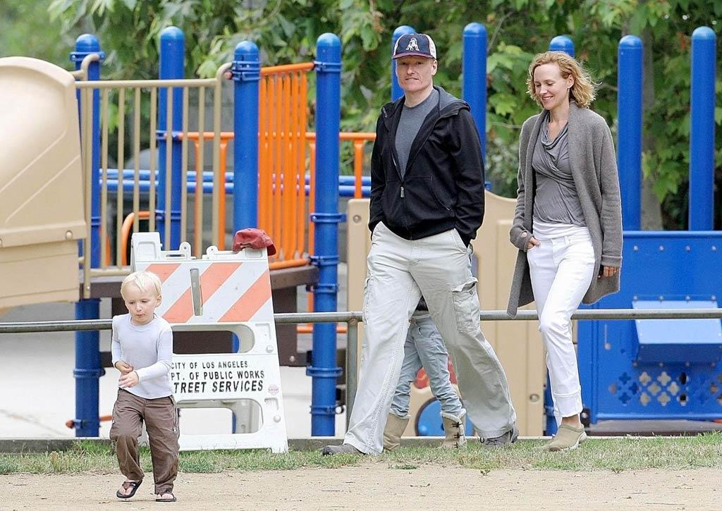 "Welcome to the jungle gym: Conan and his wife, Liza, took 3-year-old Beckett to the park for some relaxation the day before his ""Tonight Show"" debut. Gaz Shirley/Kevin Perkins/<a href=""http://www.pacificcoastnews.com/"" target=""new"">PacificCoastNews.com</a> - May 31, 2009"