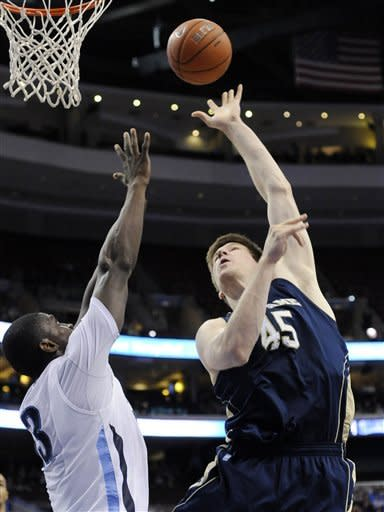 Notre Dame's Jack Cooley (45) shoots over Villanova's Mouphtaou Yarou (13) in the first half of an NCAA college basketball game on Saturday, Feb. 18, 2012, in Philadelphia. (AP Photo/Michael Perez)