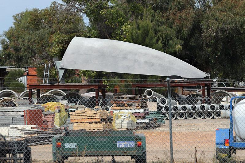 Public artwork 'The Pilot', which cost the Bunbury City Council $100,000, sits in a council depot on Nuytsia Avenue.