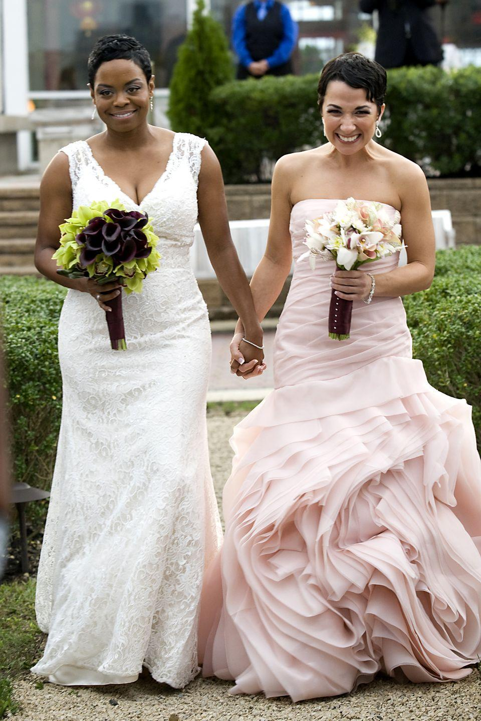 <p>The brides picked the perfect bouquets to complement their dresses at their wedding on September 30, 2011.</p>