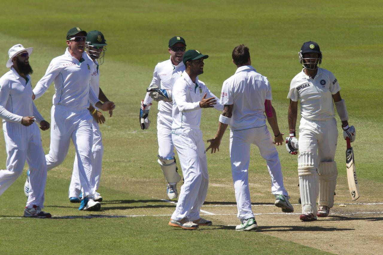 South Africa's players celebrate the wicket of India's Cheteshwar Pujara during the fifth day of the second test cricket match Durban, December 30, 2013. REUTERS/Rogan Ward (SOUTH AFRICA - Tags: SPORT CRICKET)