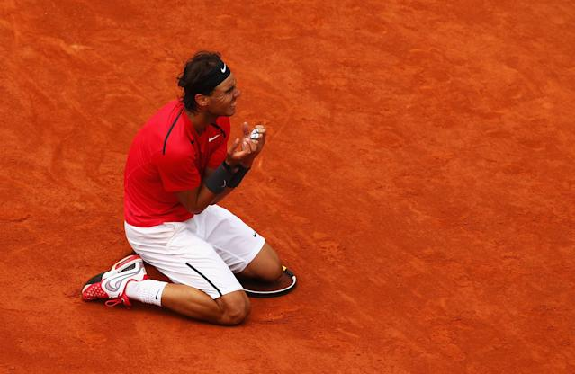 PARIS, FRANCE - JUNE 11: Rafael Nadal of Spain celebrates victory in the men's singles final against Novak Djokovic of Serbia during day 16 of the French Open at Roland Garros on June 11, 2012 in Paris, France. (Photo by Clive Brunskill/Getty Images)