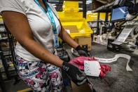 An Amazon.com Inc worker prepares an order in which the buyer asked for an item to be gift wrapped at a fulfillment center in Shakopee