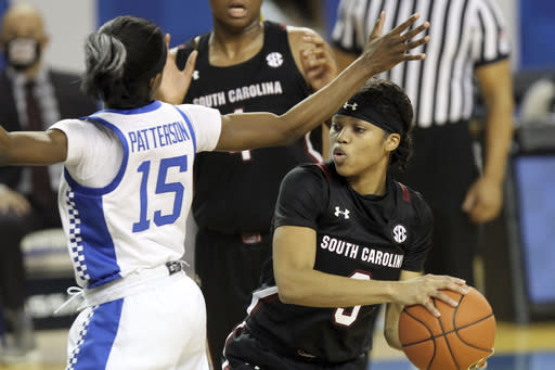 South Carolina's Destanni Henderson, right, is pressured by Kentucky's Chasity Patterson, left, during the second half of an NCAA college basketball game in Lexington, Ky., Sunday, Jan. 10, 2021. (AP Photo/James Crisp)