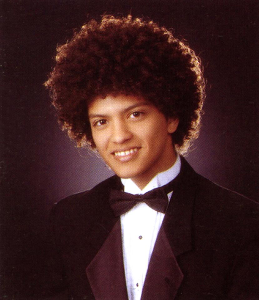 <p>Bruno Mars' swag is evident early on his senior year portrait — the afro and thousand-watt smile are already memorable. <i>(Photo: Seth Poppel/Yearbook Library)</i></p>