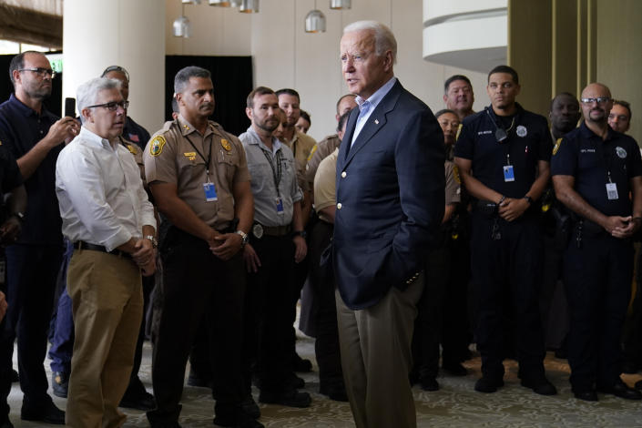 President Biden meets with first responders who were working on the condo tower that collapsed in Surfside, Fla., Thursday. (AP Photo/Susan Walsh)