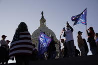 With the U.S. Capitol building in the background, supporters of President Donald Trump attend a pro-Trump march Saturday Nov. 14, 2020, in Washington. (AP Photo/Jacquelyn Martin)