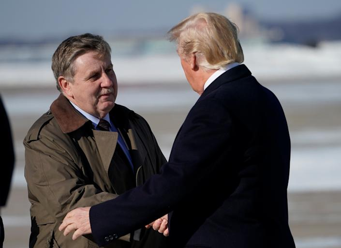 Rick Saccone, the Republican candidate in the special election for Pennsylvania's 18th District, greets President Donald Trump upon arrival at Pittsburgh International Airport on Jan. 18. Trump held a rally in support of the GOP tax cut legislation that doubled as a campaign event for Saccone.