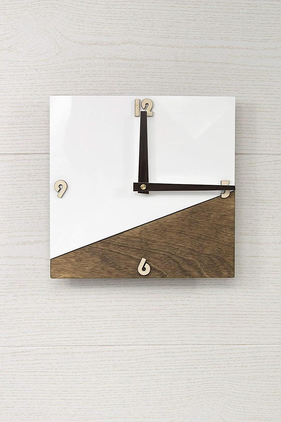 <p>The <span>Modern Glass and Wood Wall Clock</span> ($34) will tie a modern room together.</p>