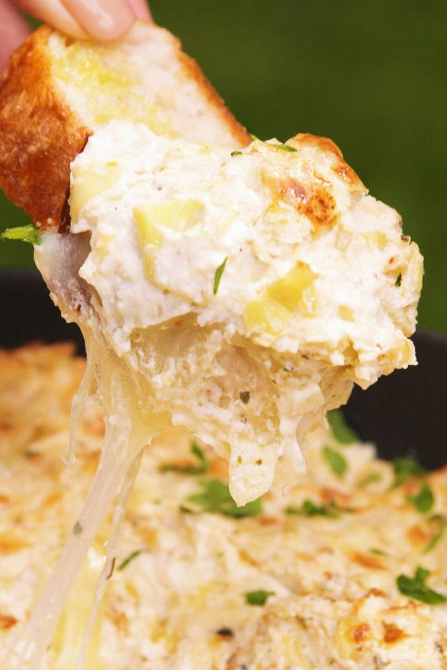 """<p>Extra cheese makes it extra good.</p><p>Get the recipe from <a rel=""""nofollow"""" href=""""http://www.delish.com/cooking/recipe-ideas/recipes/a55236/baked-three-cheese-artichoke-dip-recipe/"""">Delish</a>.</p><p><em><strong>BUY NOW: Enameled Cast-Iron Skillet, $46, <a rel=""""nofollow"""" href=""""https://www.amazon.com/Lodge-EC11S33-Enameled-Skillet-Caribbean/dp/B000N4UWRO?tag=syndication-20&&ascsubtag=delish.article.55236"""">amazon.com</a>.</strong></em></p>"""