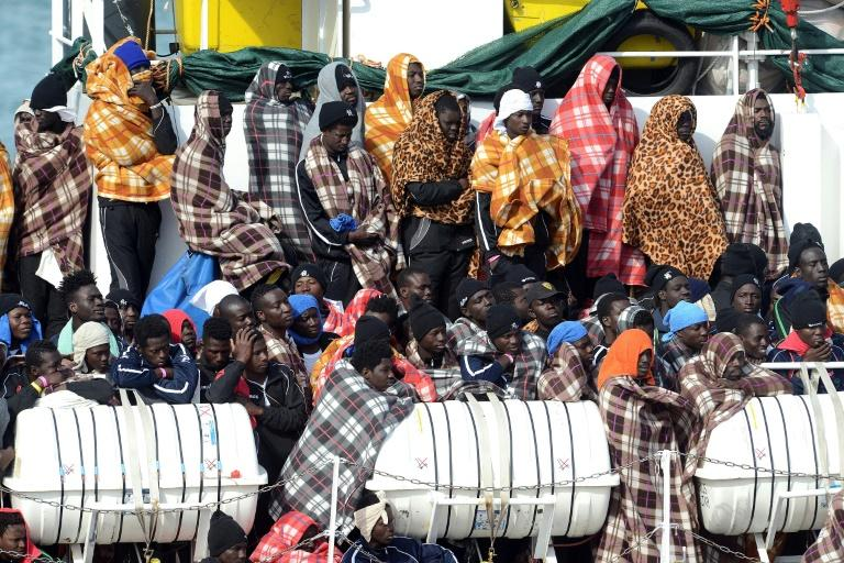 Would be immigrants wait to disembark in the port of Catania, on the island of Sicily in March 2017