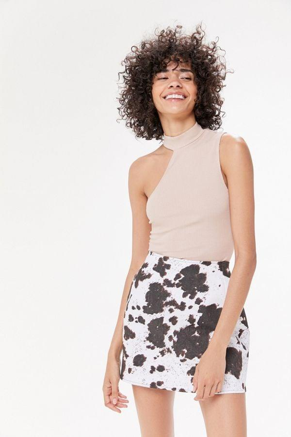 """<p>We're obsessing over the print on this <a href=""""https://www.popsugar.com/buy/Motel-Pelmo-Cow-Print-Mini-Skirt-482003?p_name=Motel%20Pelmo%20Cow%20Print%20Mini%20Skirt&retailer=urbanoutfitters.com&pid=482003&price=49&evar1=fab%3Auk&evar9=46516844&evar98=https%3A%2F%2Fwww.popsugar.com%2Ffashion%2Fphoto-gallery%2F46516844%2Fimage%2F46517334%2FMotel-Pelmo-Cow-Print-Mini-Skirt&list1=shopping%2Cfall%20fashion%2Cfall%2Curban%20oufitters&prop13=api&pdata=1"""" rel=""""nofollow"""" data-shoppable-link=""""1"""" target=""""_blank"""" class=""""ga-track"""" data-ga-category=""""Related"""" data-ga-label=""""https://www.urbanoutfitters.com/shop/motel-pelmo-cow-print-mini-skirt?category=skirts&amp;color=009&amp;type=REGULAR"""" data-ga-action=""""In-Line Links"""">Motel Pelmo Cow Print Mini Skirt</a> ($49).</p>"""