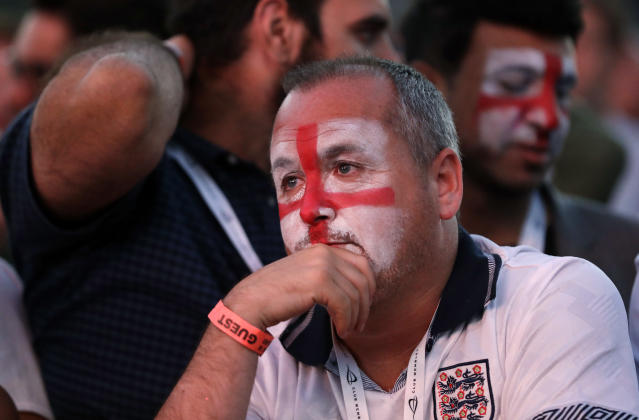 An England soccer fan reacts after Croatia scored their side's second goal as he watches a live broadcast on a big screen of the semifinal match between Croatia and England at the 2018 soccer World Cup, in Hyde Park, London, Wednesday, July 11, 2018. (AP Photo/Matt Dunham)