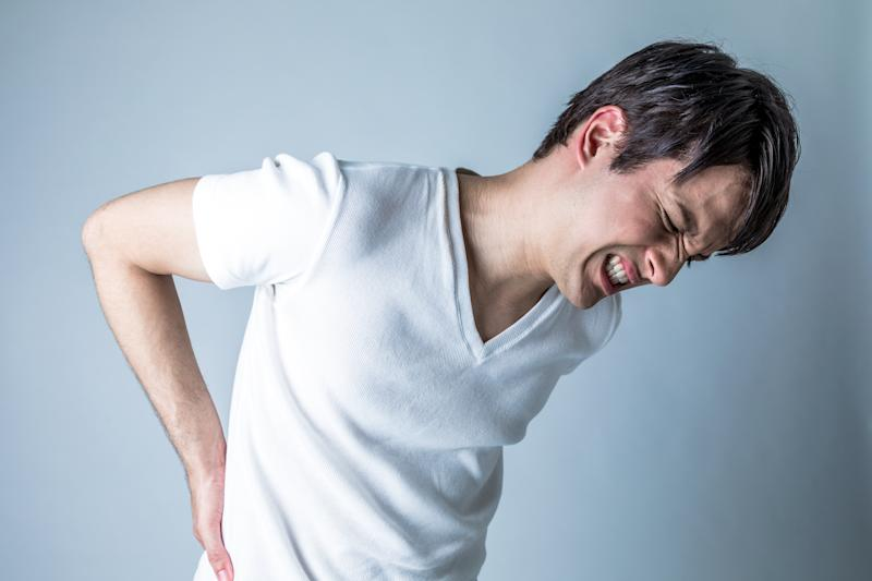 young man having a pain in lower back