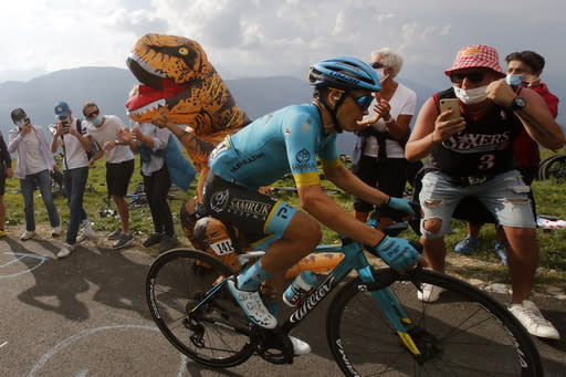 Roglic extends overall Tour lead; Lopez wins toughest stage