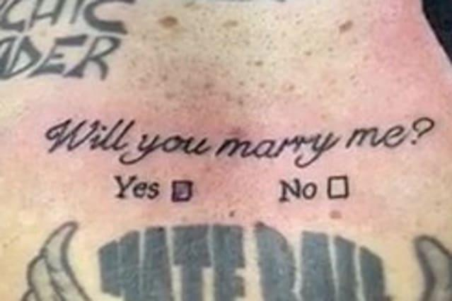 """Man with more than 20 tattoos adds to his collection as he pops the question to his girlfriend with tattoo that reads """"Will you marry me?"""" - complete with 'Yes/No' tick-boxes"""