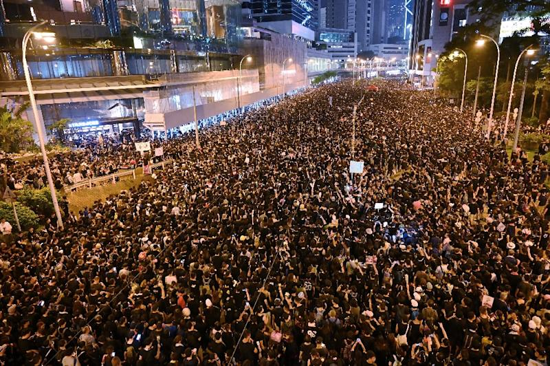 Thousands of Hong Kong protesters marched to call for the full withdrawal of an extradition bill. (AFP Photo/HECTOR RETAMAL)