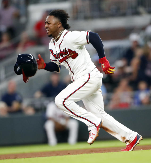 Atlanta Braves second baseman Ozzie Albies (1) loses his helmet as he steals second base in the third inning of a baseball game against the Chicago Cubs Tuesday, May 15, 2018, in Atlanta. (AP Photo/John Bazemore)