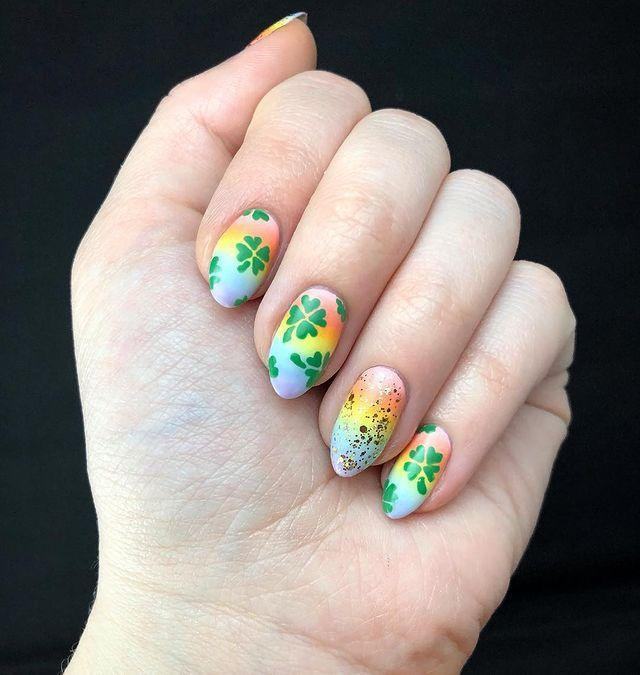 """<p>What lies over the rainbow? We hope it's this manicure with it's colorful gradient and shamrock designs (and a pot of gold).</p><p><strong>RELATED:</strong> <a href=""""https://www.goodhousekeeping.com/holidays/g4959/st-patricks-day-quotes/"""" rel=""""nofollow noopener"""" target=""""_blank"""" data-ylk=""""slk:25 Best St. Patrick's Day Quotes to Celebrate All Things Irish"""" class=""""link rapid-noclick-resp"""">25 Best St. Patrick's Day Quotes to Celebrate All Things Irish</a></p><p><a href=""""https://www.instagram.com/p/BvExiRQg483/&hidecaption=true"""" rel=""""nofollow noopener"""" target=""""_blank"""" data-ylk=""""slk:See the original post on Instagram"""" class=""""link rapid-noclick-resp"""">See the original post on Instagram</a></p>"""