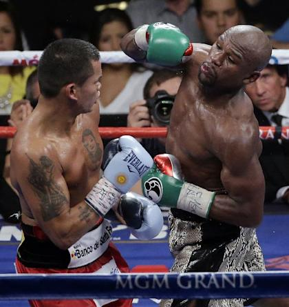 Boxing matches are typically on pay-per-view, which is the case when Floyd Mayweather (R) fights. (AP)