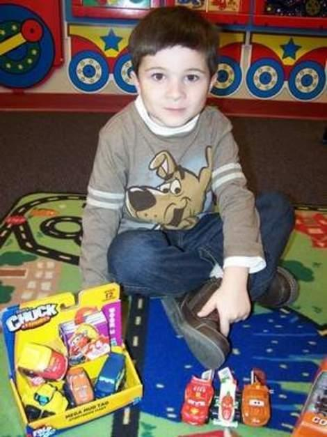 Ben in the library playroom he upgraded with his allowance.