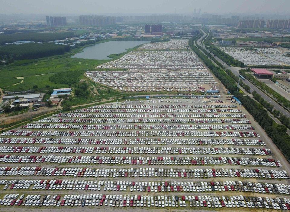 New cars in a parking lot of the Brilliance factory in the Liaoning provincial capital of Shenyang in north-eastern China on July 17, 2017. Photo: AFP