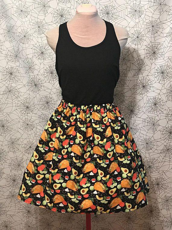 """<a href=""""https://www.etsy.com/listing/545683164/taco-skirt-taco-tuesday-avocado-skirt-i?ga_order=most_relevant&ga_search_type=all&ga_view_type=gallery&ga_search_query=tacos&ref=sr_gallery_6"""" target=""""_blank"""">Shop it here</a>."""