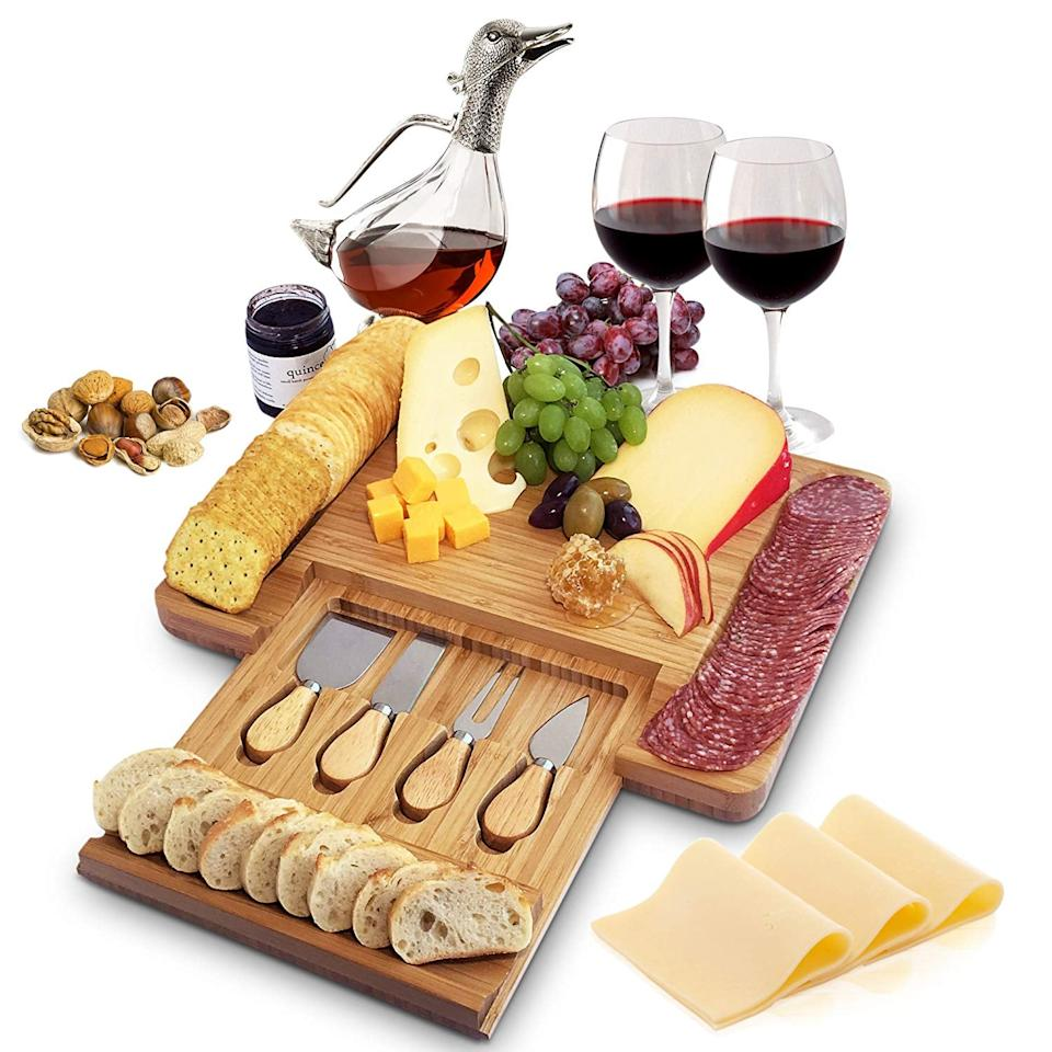 """<p>This <a href=""""https://www.popsugar.com/buy/Natural-Bamboo-Cheese-Board-Cutlery-Set-Slide-out-Drawer-462851?p_name=Natural%20Bamboo%20Cheese%20Board%20and%20Cutlery%20Set%20With%20Slide-out%20Drawer&retailer=amazon.com&pid=462851&price=40&evar1=savvy%3Aus&evar9=46834508&evar98=https%3A%2F%2Fwww.popsugar.com%2Fsmart-living%2Fphoto-gallery%2F46834508%2Fimage%2F46834597%2FNatural-Bamboo-Cheese-Board-Cutlery-Set-With-Slide-out-Drawer&list1=shopping%2Cgifts%2Choliday%2Cgift%20guide%2Cgifts%20for%20women&prop13=api&pdata=1"""" rel=""""nofollow"""" data-shoppable-link=""""1"""" target=""""_blank"""" class=""""ga-track"""" data-ga-category=""""Related"""" data-ga-label=""""https://www.amazon.com/Slide-out-Home-Euphoria-Charcuterie-Housewarming/dp/B074BWTMWQ"""" data-ga-action=""""In-Line Links"""">Natural Bamboo Cheese Board and Cutlery Set With Slide-out Drawer</a> ($40, originally $50) is great for entertaining.</p>"""