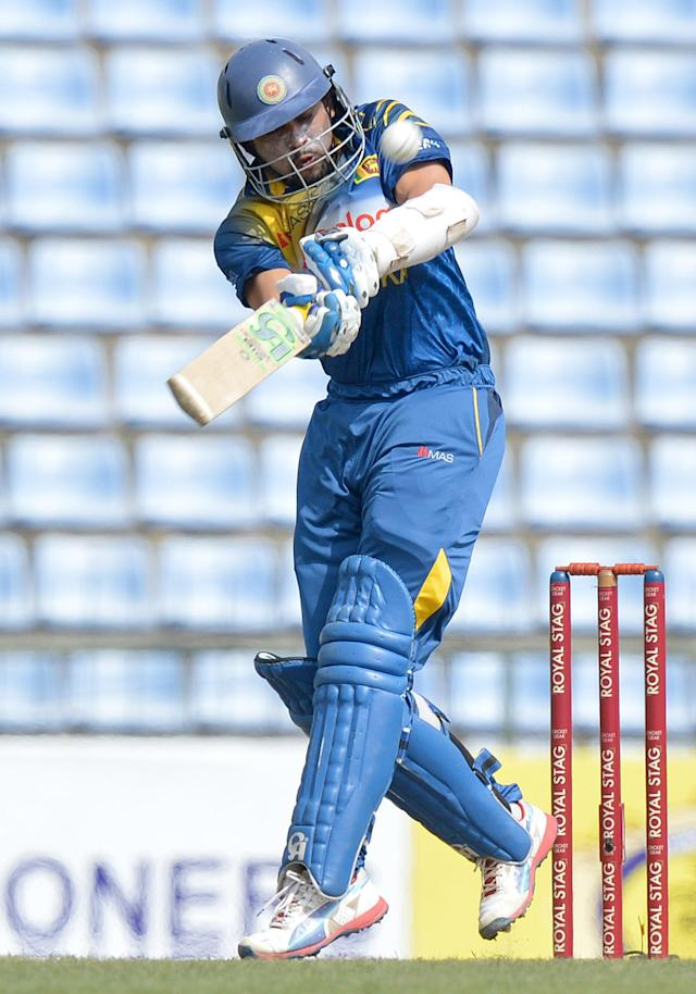 Sri Lankan batsman Tillakaratne Dilshan plays a shot during the second One Day International match between South Africa and Sri Lanka at the Pallekele stadium in Pallekele on July 9, 2014 (AFP Photo/Ishara S. Kodikara)