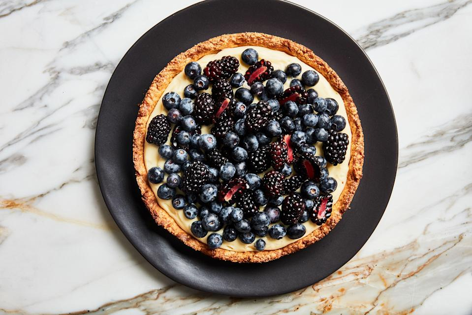 """The key to the flavorful crust for this summery fruit tart is letting it bake until it's really well-browned throughout, which might mean letting it get a bit darker than you're used to. <a href=""""https://www.bonappetit.com/recipe/fruit-tart-with-almond-crust?mbid=synd_yahoo_rss"""" rel=""""nofollow noopener"""" target=""""_blank"""" data-ylk=""""slk:See recipe."""" class=""""link rapid-noclick-resp"""">See recipe.</a>"""