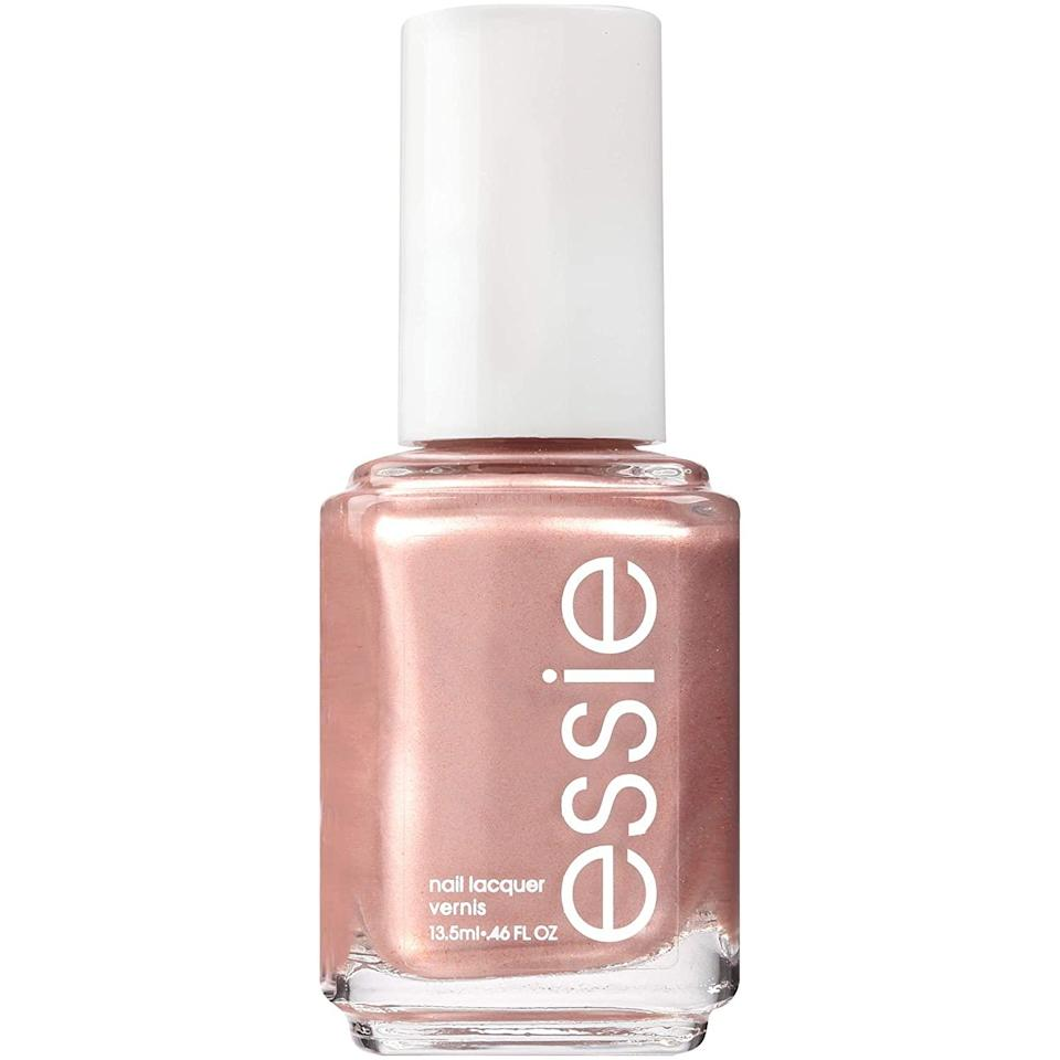 """<p>Happy birthday, Libra! It's your time to shine, which means adorning your nails with extra fabulousness this month. Embrace your innate luxurious vibe and paint your nails rose gold. Go full out to pull out all the stops on revving up your glam look with champagne wishes and caviar dreams.</p> <p><strong>To shop: </strong>$9; <a href=""""https://www.amazon.com/essie-Polish-Glossy-Shine-Finish/dp/B000CP0PJ4/ref=as_li_ss_tl?ie=UTF8&linkCode=ll1&tag=isbeuhaircolorsforlibraseasonlstardustsep20-20&linkId=8e6daae76cca8eff33179790b68d5ae9"""" rel=""""nofollow noopener"""" target=""""_blank"""" data-ylk=""""slk:amazon.com"""" class=""""link rapid-noclick-resp"""">amazon.com</a></p>"""