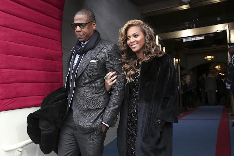 FILE - This Jan. 21, 2013 file photo shows recording artists Jay-Z and Beyonce at the Capitol in Washington for the Presidential Barack Obama's ceremonial swearing-in ceremony during the 57th Presidential Inauguration. Jay-Z and Beyonce sat tightly with Solange. Kelly Rowland embraced Beyonce with a huge hug. And Rihanna spilled some of her drink laughing with Rowland as Music's top stars attended the annual pre-Grammy Roc Nation brunch on Saturday, Feb. 9, at the Soho House in Los Angeles on the eve of the Grammy Awards. (AP Photo/Win McNamee, Pool, file)