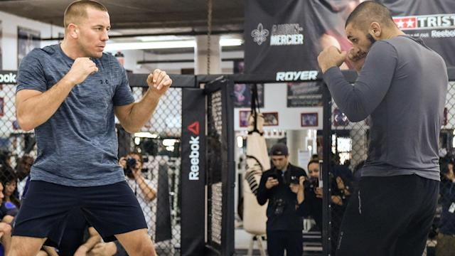 Will Georges St-Pierre be victorious in his return to the Octagon, or will Michael Bisping upend him?