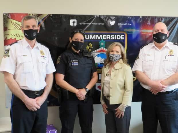 Const. Mallory Metallic, second from left, is welcomed to the Summerside Police Service by Deputy Chief Sinclair Walker, Coun. Barb Ramsay and Chief Dave Poirier. (Summerside Police Services/Facebook - image credit)