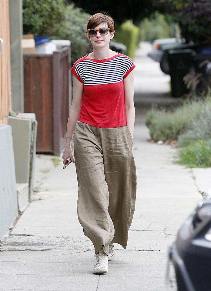 Anne Hathaway wears baggy pants as she visits a friend in Silver Lake