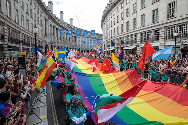 <p>A giant rainbow flag is carried down Regent Street during the Pride in London Festival on July 8, 2017 in London, England. (Photo: Jack Taylor/Getty Images) </p>