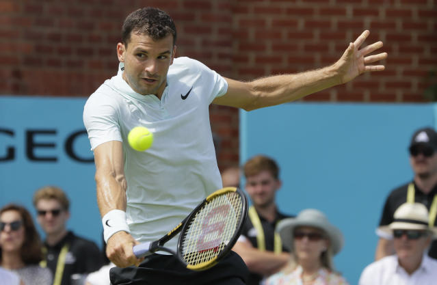 Grigor Dimitrov of Bulgaria plays a return to Damir Dzumhur of Bosnia and Herzegovina during their singles tennis match at the Queen's Club tennis tournament in London, Tuesday, June 19, 2018. (AP Photo/Kirsty Wigglesworth)