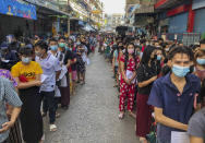 People stand in lines to get COVID-19 tests in Samut Sakhon, South of Bangkok, Thailand, Sunday, Dec. 20, 2020. Thailand reported more than 500 new coronavirus cases on Saturday, the highest daily tally in a country that had largely brought the pandemic under control. (AP Photo/Jerry Harmer)